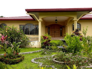 Front Door, Port Cochere and Sunken Garden in front of House