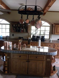 Kitchen Island and Wrought Iron Pot Rack